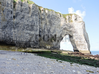 cliff with arch on pebble beach of Eretrat