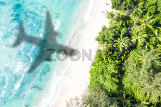 Symbolic picture vacation travel traveling sea airplane flying Seychelles aerial photo beach