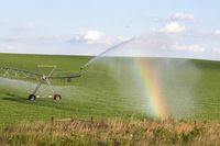 Pivot running in field with beauful rainbow on sunny day . July 22, 2019, O'Nell, Holt county, Nebraska
