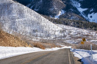 scenic windy mountain road in winter scenery