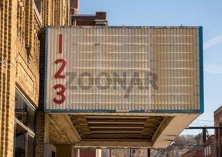 Empty movie theater billboard on typical US downtown Main Street cinema