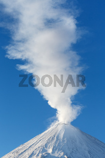 Winter view of top of active volcano eruption