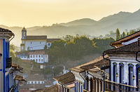 Facades of houses and church in colonial architecture in an old street in the city of Ouro Preto