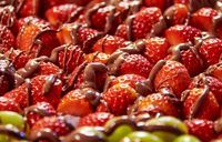 fresh fruit dessert from grapes strawberries and chaocolate