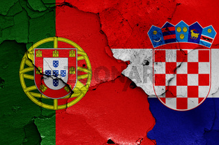 flags of Portugal and Croatia painted on cracked wall