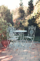 Terrace with vintage table and chairs
