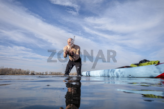 senior male with stand up paddleboard