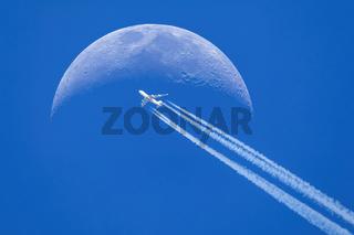 Passenger plane passes near the sun