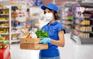 delivery girl in mask with food in box at store
