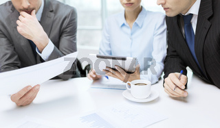 business team with graph, tablet pc and coffee