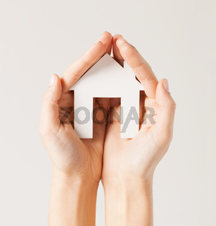 woman hands with paper house