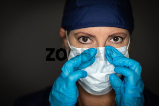 Female Doctor or Nurse Wearing Surgical Gloves Putting On Medical Face Mask