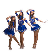 Showgirls in sailor style dresses shot