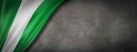 Nigerian flag on concrete wall banner