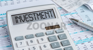 A calculator with the word Investment on the display