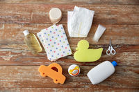 baby accessories for bathing on wooden table