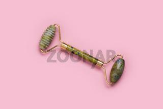 Guasha green natural gemstone face roller. Anti aging self care tool.