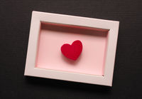 Red wooden heart shape in a gift box