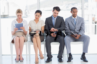Business people waiting for job interview in office
