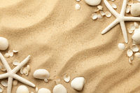 Starfishes, Stones And Seashells On Sand Background