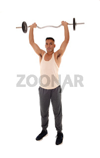 Young east Indian man standing weigh lifting