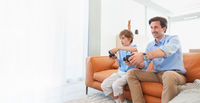 Father and son play video game