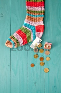 euro money in the sock. retirement savings and hiding concept. depositing money in a sock