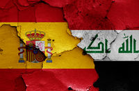 flags of Spain and Iraq painted on cracked wall