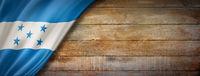 Honduras flag on vintage wood wall banner