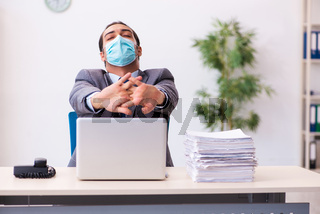 Young male employee wearing mask during pandemic
