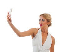 Young woman taking selfie
