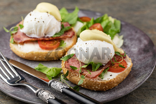 Eggs Benedict with salad