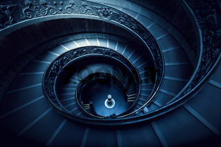 Long spiral, winding stairs. Dark shadows, soft light.