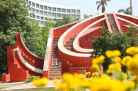 Historical Observatory at Jantar Mantar with bokeh of yellow flowers