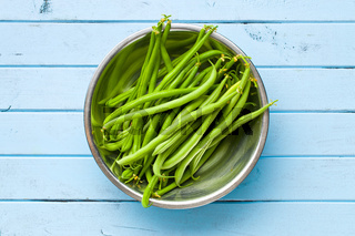 green beans on blue kitchen table