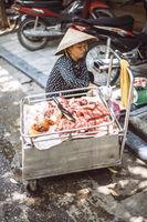 Hanoi, Vietnam - May 2, 2015: Vietnamese street market lady seller, on May 2, 2015, in Hanoi, Vietnam