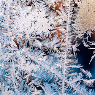frosty pattern on frozen window glass