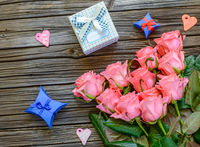 Roses and Valentine gift boxes over old background