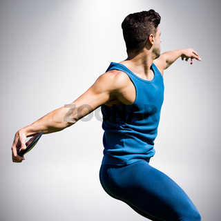Composite image of side view of man throwing discus