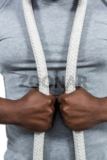 Fit man with battle rope