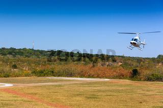 Helicopter landing on helipad.
