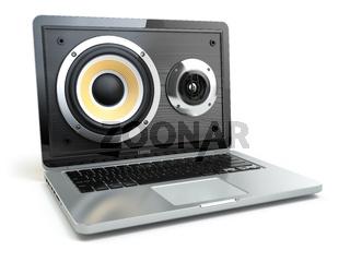 Digital audio or music software concept. Laptop and loudspeaker.