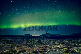 Aurora Borealis over distant mountains