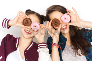 happy pretty teenage girls with donuts having fun