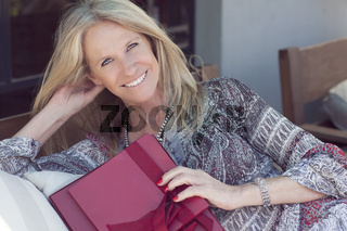 Happy Cute middle age woman with gift