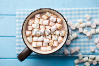 Cocoa drink with marshmallows in mug