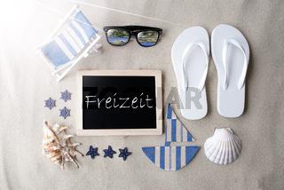 Sunny Blackboard On Sand, Freizeit Means Leisure Time