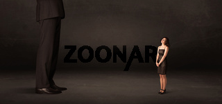 Huge man with small businesswoman standing at front concept