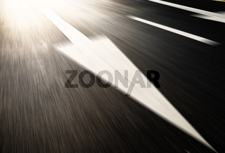 asphalt road with traffic signs under light