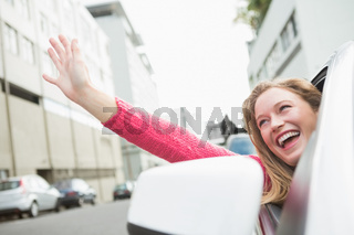 Young woman smiling and waving
